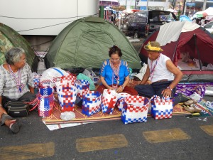 Protesters make merchandise to sell