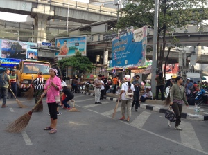 Protesters sweeping the street