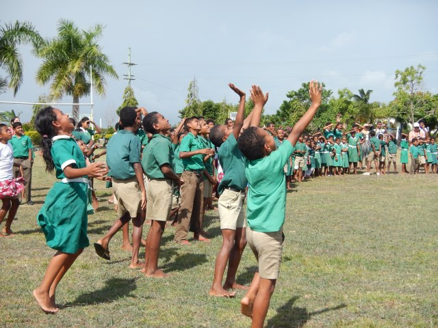 Children watch a drone at RMKS Primary School in Fiji