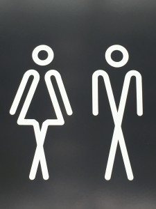 Crossed-leg toilet sign
