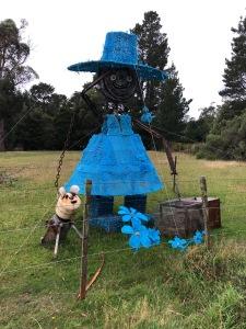 Female farmer sculpture in blue dress