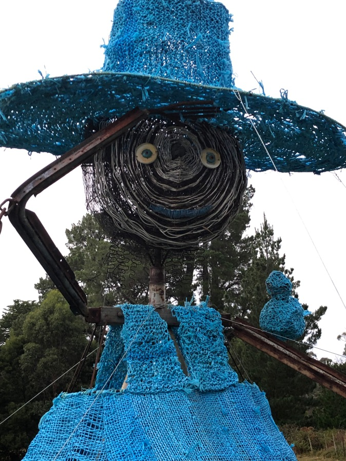 Sire sculpture of female farmer with blue hat